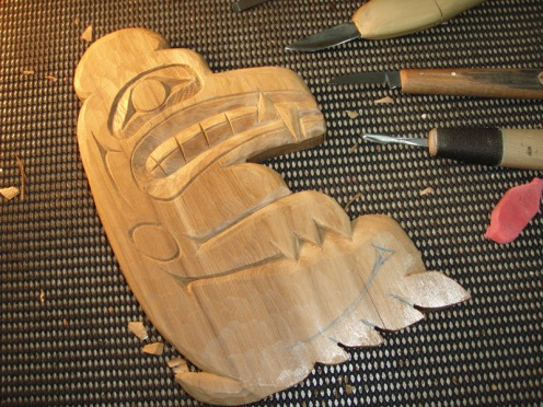 Carved over a dozen Bear Plaques