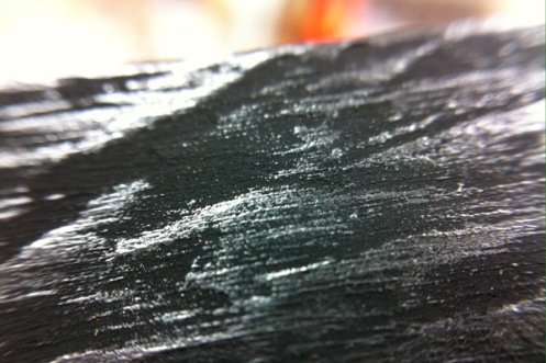 Multiple layers of gouache and graphite dust to achieve the Raven's beak texture