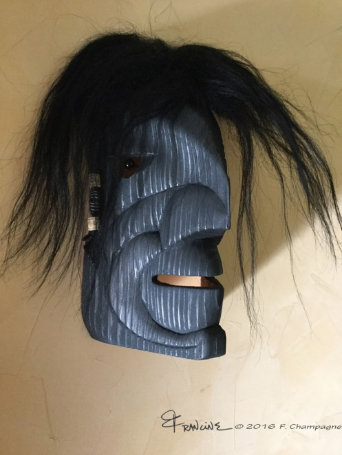 Raven Man mask, the sixth, sporting some hair beads