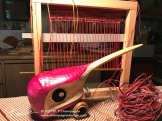 Small loom with Anna's Male waiting for his throat patch to be completed.