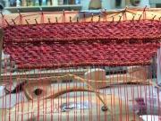 Waxed linen, raffia, glass beads